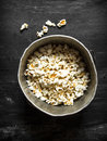 Popcorn in an old pot. Royalty Free Stock Photo