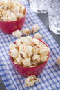 Popcorn for the party served in a red cup Royalty Free Stock Photography