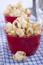 Popcorn for the party served in a red cup Stock Images