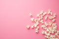 Popcorn on pink background Royalty Free Stock Photo