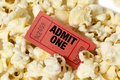 Popcorn with red ticket close up shot of a movie surrounded by Royalty Free Stock Images