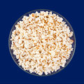 Popcorn snack closeup on blue background Royalty Free Stock Photo