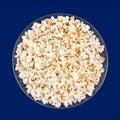 Popcorn snack closeup on blue background Royalty Free Stock Photo