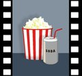 Popcorn and soda can with film strip border Stock Photography