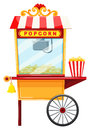 Popcorn vendor with wheel and bell Royalty Free Stock Photo