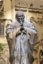 Notre Dame Cathedral Pope prayer Saint John Paul II statue. Faith and religion. france Paris Royalty Free Stock Photo
