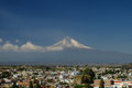 Popocatepetl Volcano Towering over the town of Puebla Royalty Free Stock Photo