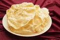 Poppadoms on a plate pile of resting red cloth Stock Photos