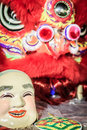 Popper smiling mask and red lion dance costume prepare for Chine Royalty Free Stock Photo