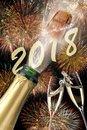 Popping champagne and fireworks at new years eve 2018 Royalty Free Stock Photo