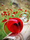 Poppy in glass still life consisting of a on a introduced the foreground with a landscape behind without definition Stock Photos