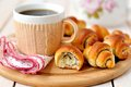 Poppy seed rugelach croissant with a cup of coffee tea Royalty Free Stock Images