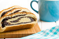 Poppy seed strudel on kitchen table Royalty Free Stock Photography