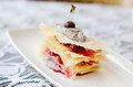 Poppy seeds dessert with pastry and cherries Stock Images