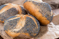 Poppyseed buns on an old dark wooden table detailed close up shot Stock Photos