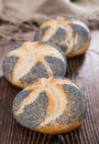 Poppyseed buns on an old dark wooden table detailed close up shot Royalty Free Stock Photo