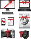 Popular electronic devices packed as presents with red ribbons Royalty Free Stock Photo