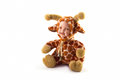 Porcelain baby doll wearing giraffe suit Royalty Free Stock Photos