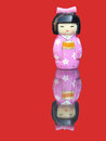 Porcelain chinese figurine with mirror image on a red background front view Royalty Free Stock Photos