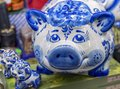 stock image of  Porcelain figurines of a pig and two piglets made in the Russian style Gzhel