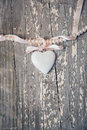 Porcelain heart on wooden background Royalty Free Stock Photography