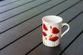 Porcelain mug on a garden table Stock Images