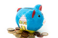 Porcelain piggy bank with coins Royalty Free Stock Photo