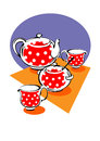 Porcelain red tea service with white polka dots Stock Photo