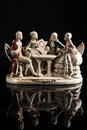 Porcelain sculpture of people playing cards decorative sculptural group game painted made in germany in two men and two women Royalty Free Stock Image