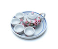 Porcelain tea pot and cup on white Royalty Free Stock Photography