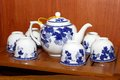 Porcelain tea set on wooden tray image of a white with blue floral designs a lacquered Royalty Free Stock Photos