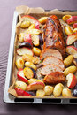 Pork baked with vegetables on a tray fillet Royalty Free Stock Images