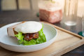 Pork bun on wood table in cafe Royalty Free Stock Photo