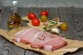 Pork carbonate on a wooden kitchen table Royalty Free Stock Photography