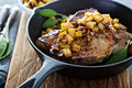 Pork chops with apples and walnuts Royalty Free Stock Photo