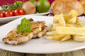 Pork chops with french fries Royalty Free Stock Photo