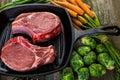 Pork chops organic lion of thick cut on cast iron frying pan Stock Photo