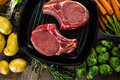 Pork chops organic lion of thick cut on cast iron frying pan Royalty Free Stock Photography
