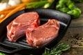 Pork chops organic lion of thick cut on cast iron frying pan Stock Photos