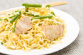 Pork chow mein with chopsticks in white plate Royalty Free Stock Photography