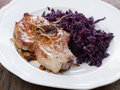 Pork cutlet with blue kraut Royalty Free Stock Photos