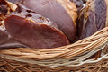 Pork ham placed in a wicker basket traditional romanian food shall specify particular for the month of december Royalty Free Stock Image