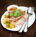 Pork leg with rice on wood background Royalty Free Stock Image