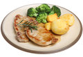 Pork loin meat steaks with vegetables roast potatoes broccoli and gravy Royalty Free Stock Images