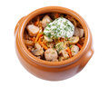 Pork with mushrooms, carrots and onions in a ceramic crock pot, Stock Images