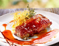 Pork ribs in barbecue sauce with potato Royalty Free Stock Image