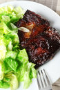 Pork ribs with green salad shot from above Royalty Free Stock Photo