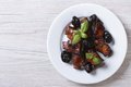 Pork ribs stewed with prunes on a plate horizontal top view from above Stock Image