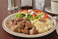 Pork roast dinner served with mashed potatoes and gravy and salad Royalty Free Stock Photos
