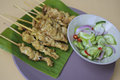 Pork satay thai traditions food with peanut sauce Stock Photography